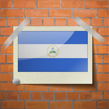 scotch: Flags of Nicaragua scotch taped to a red brick wall. Vector