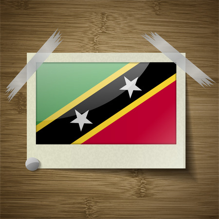 correctly: Flags of Saint Kitts and Nevis at frame on wooden texture. Vector illustration