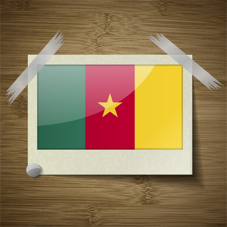 Flags of cameroon at frame on wooden texture. Vector illustration Vector