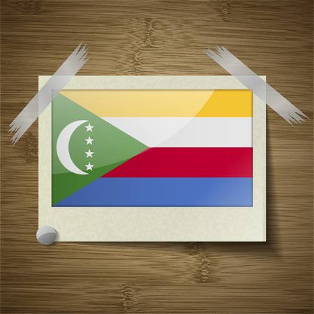 comoros: Flags of Comoros at frame on wooden texture. Vector illustration