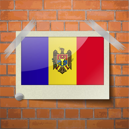 moldovan: Flags of Moldova scotch taped to a red brick wall. Vector