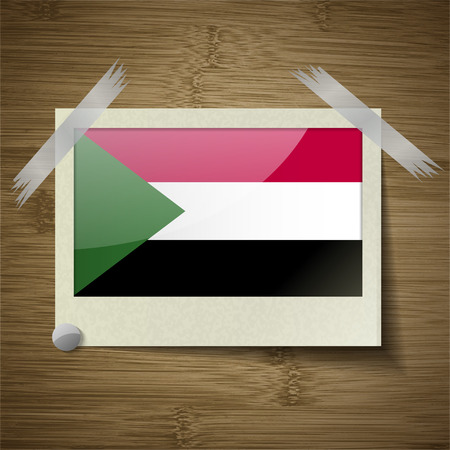 sudan: Flags of Sudan at frame on wooden texture. Vector illustration