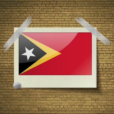 timor: Flags of East Timor at frame on a brick background. Vector illustration