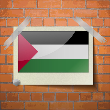 flagged: Flags of Palestine scotch taped to a red brick wall. Vector