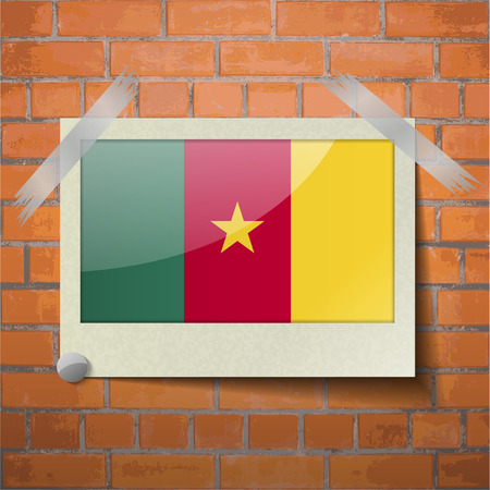 Flags of cameroon scotch taped to a red brick wall. Vector Vector