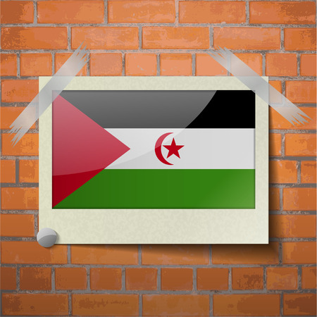 landlocked country: Flags of Western Sahara scotch taped to a red brick wall. Vector Illustration