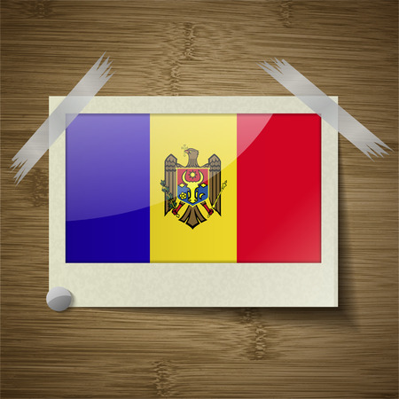 moldovan: Flags of Moldova at frame on wooden texture. Vector illustration Illustration