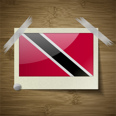 trinidadian: Flags of Trinidad and Tobago at frame on wooden texture. Vector illustration