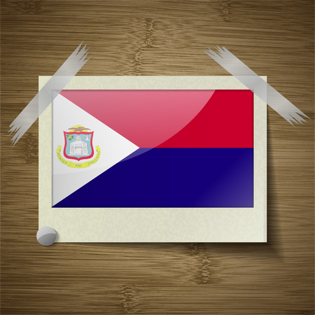 martin: Flags of Saint Martin at frame on wooden texture. Vector illustration