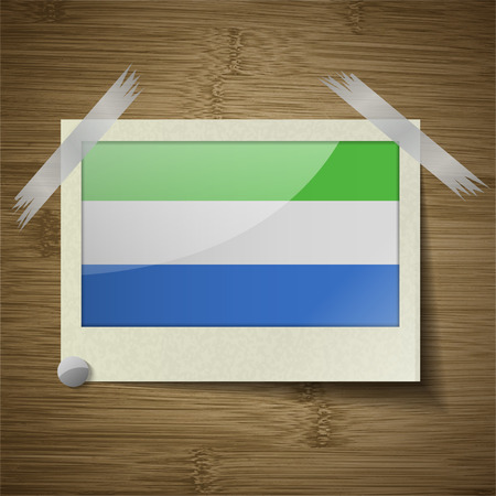 correctly: Flags of SIERRA lEONE at frame on wooden texture. Vector illustration