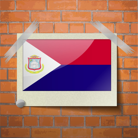 martin: Flags of Saint Martin scotch taped to a red brick wall. Vector