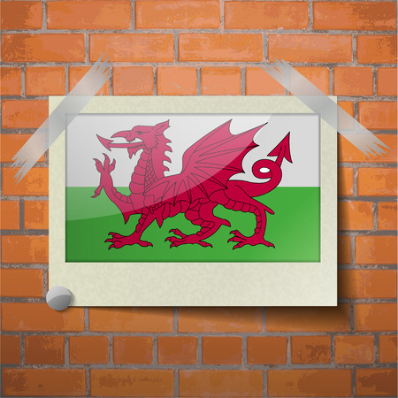 cymru: Flags of Wales scotch taped to a red brick wall. Vector