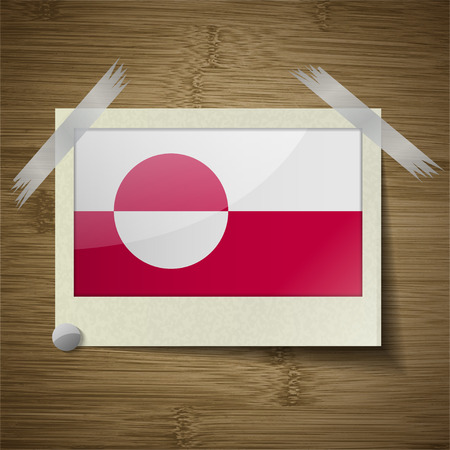 greenland: Flags of Greenland at frame on wooden texture. Vector illustration