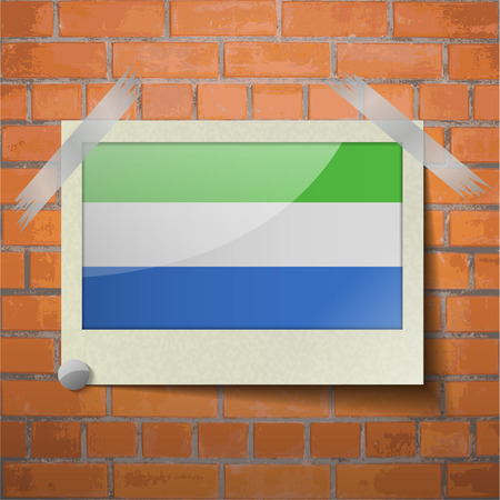 proportional: Flags of SIERRA lEONE scotch taped to a red brick wall. Vector