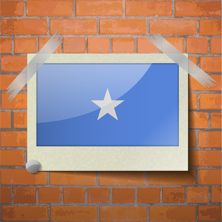 flagged: Flags of Somalia scotch taped to a red brick wall. Vector