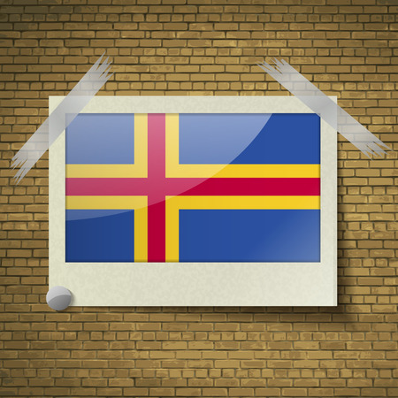 european culture: Flags of Aland at frame on a brick background. Vector illustration