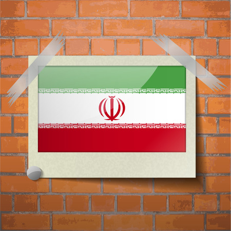 Flags of Iran scotch taped to a red brick wall. Vector