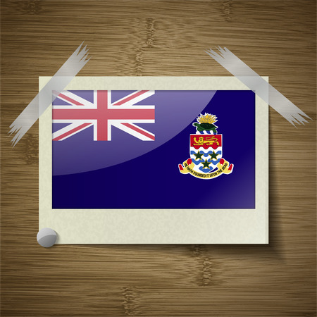 cayman: Flags of Cayman Islands at frame on wooden texture. Vector illustration