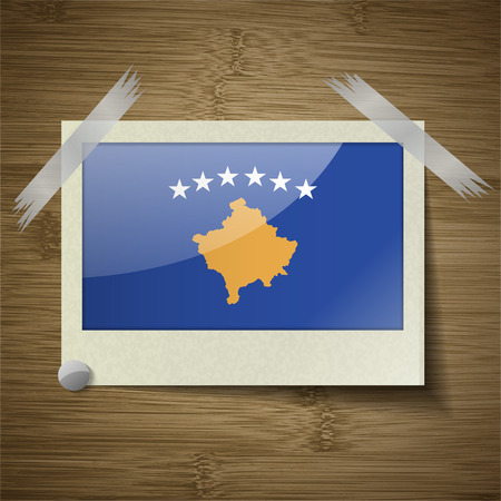 travel locations: Flags of Kosovo at frame on wooden texture. Vector illustration