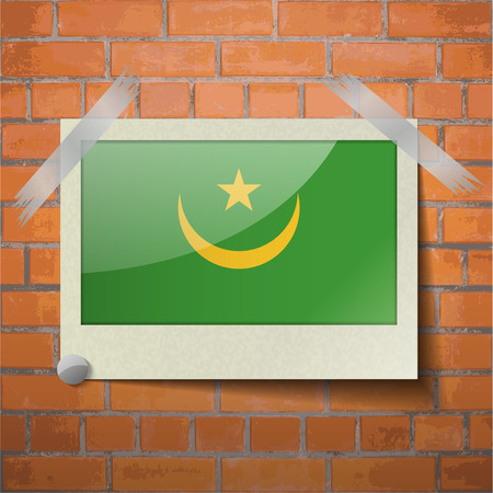 moresque: Flags of Mauritania scotch taped to a red brick wall. Vector