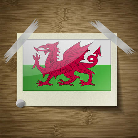 cymru: Flags of Wales at frame on wooden texture. Vector illustration Stock Photo