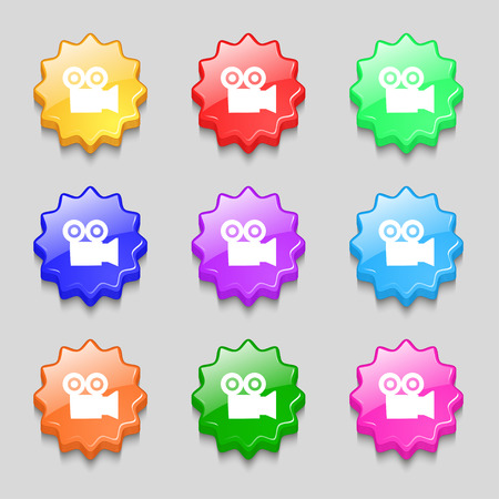 photocamera: video camera icon sign. symbol on nine wavy colourful buttons. Vector illustration Illustration
