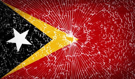 east: Flags of East Timor with broken glass texture. Vector illustration