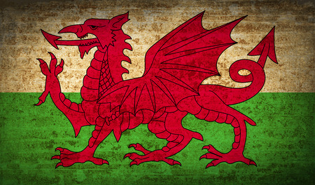 Flags of Wales with dirty paper texture. Vector illustration