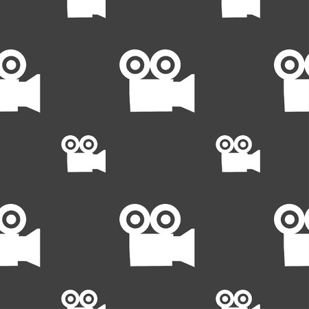 digicam: video camera icon sign. Seamless pattern on a gray background. Vector illustration