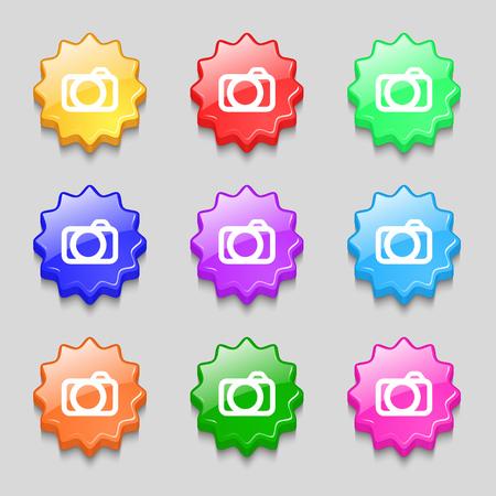 digital photo: Photo camera sign icon. Digital photo camera symbol. Symbols on nine wavy colourful buttons. Vector illustration