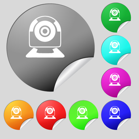 video chat: Webcam sign icon. Web video chat symbol. Camera chat. Set of eight multi colored round buttons, stickers. illustration