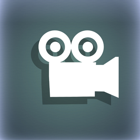 journalistic: video camera icon symbol on the blue-green abstract background with shadow and space for your text. illustration