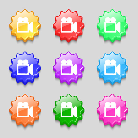 camcorder: camcorder icon sign. symbol on nine wavy colourful buttons. illustration Stock Photo