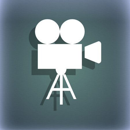 bluegreen: Video camera icon. On the blue-green abstract background with shadow and space for your text. illustration