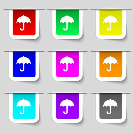 resistant: umbrella icon sign. Set of multicolored modern labels for your design. illustration