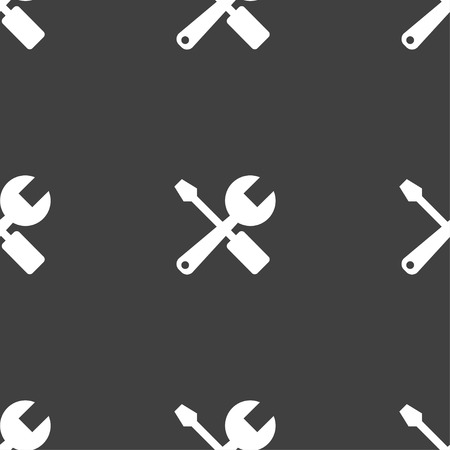 wrench and screwdriver icon sign. Seamless pattern on a gray background. Vector illustration
