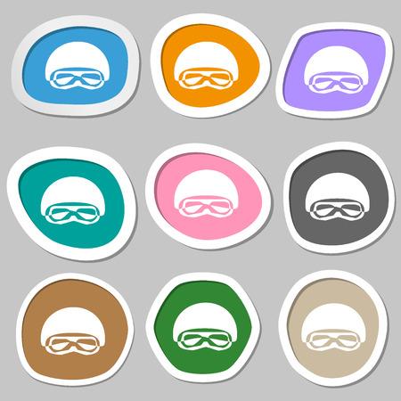 paper mask: In a ski masks, snowboard ski goggles, diving mask symbols. Multicolored paper stickers. Vector illustration