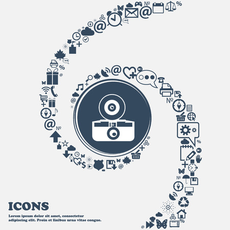 reflex camera: retro photo camera sign icon in the center. Around the many beautiful symbols twisted in a spiral. You can use each separately for your design. Vector illustration