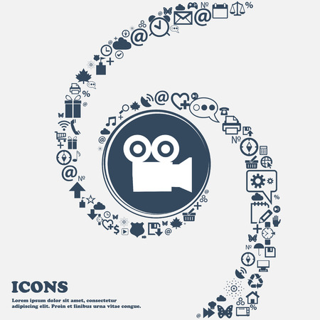 journalistic: video camera icon sign in the center. Around the many beautiful symbols twisted in a spiral. You can use each separately for your design. Vector illustration