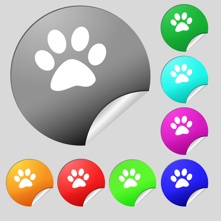 impression: paw icon sign. Set of eight multi colored round buttons, stickers. Vector illustration