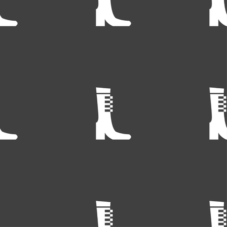 garment label: female fall and winter shoe, boot icon sign. Seamless pattern on a gray background. Vector illustration