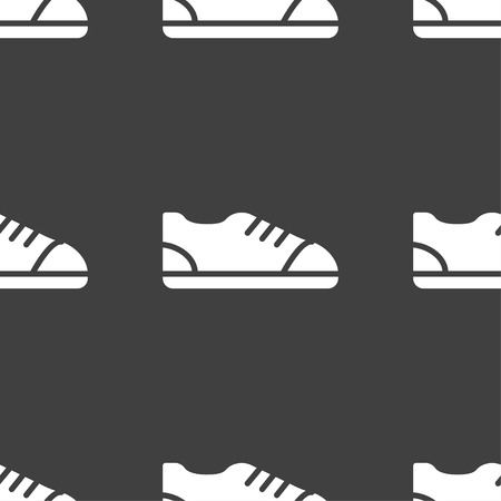 foot gear: shoe icon sign. Seamless pattern on a gray background. Vector illustration