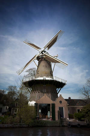 abstract mill: Dutch Mill buildings and views from the canal cruiser  Stock Photo