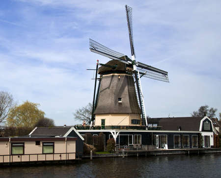 dutch windmill: Dutch Mill buildings and views from the canal cruiser  Stock Photo