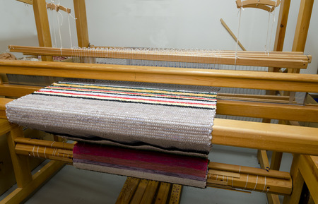 loom: Loom with a carpet showing how a loom is made