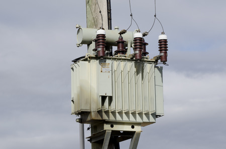 three phase: Old oil coled high voltage transformer  Stock Photo