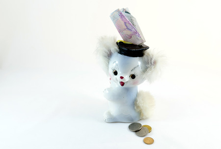 A little happy moneybox with some money coming in