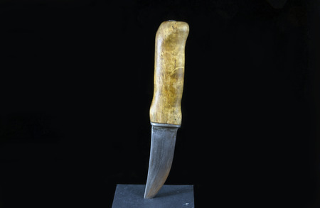 moose hunting: Hunting knife isolated on black. used in moose hunting in the North of Sweden Stock Photo