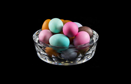 crystal bowl: Easter egg with different colors in crystal bowl, egg colored with natural substances. Stock Photo