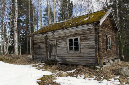 look after: Old wooden house from the North of Sweden used when the cows should be look after.